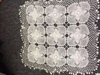 Vintage hand crocheted table cloth in cream.