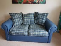 Small sofa bed in blue and tartan