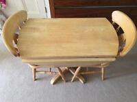 Compact folding round table and 2 chairs