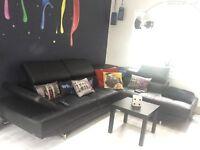 Modern black corner sofa