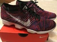 Nike Women's Pink Flyknit Zoom Agility trainers