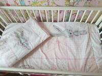 Cot bed set and bumper with nappy stacker.