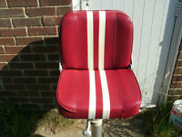 Boat seats 1 on pedastale other on brackets