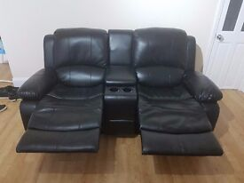 2 seater leather recliner with console.