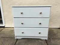 WHITE CHEST OF DRAWERS - UNUSED BUT KNOTS IN WOOD SHOWING THROUGH