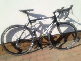 cboardman comp racing bike, 9 speed, aluminium frame with carbon forks.