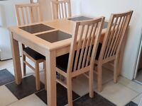 Dining Table and 4 chairs, Light Maple wood with grey granite tiles.