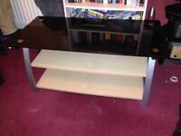 Large TV stand, three tier black glass