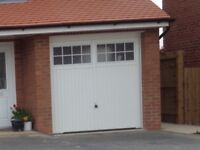 White up and over garage door from a new build house with keys