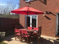 Garden table, 6 chairs and parasol with base