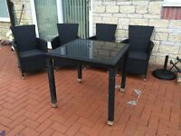 Rattan garden table and chair set.