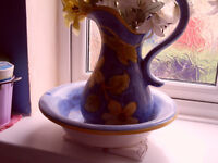 JUG AND PITCHER IN A DEEP ROYAL BLUE AND YELLO WITH A LARGE RANGE OF FALSE FLOWERS IN IT