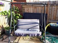 Two seater garden swing seat also has a new unused seat attachments