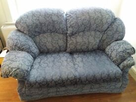 Two seater sofa in blue floral pattern