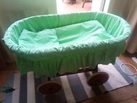 Large baby bassinet crib with wooden frame, wicker basket and wheels, complete with bedding!