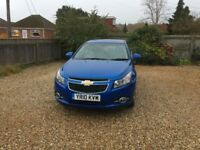 2010 CHEVROLET CRUZE 1.8iLT PETROL IN BLUE WITH MANUFACTURER FITTED REAR SPOILER AND CHROME TRIM