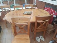 Pine dining room table & 6 chairs used condition two of the chairs are carvers with arms