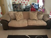 Long brown sofa used
