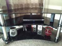 Glass corner TV unit.