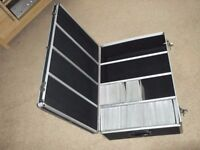 dvd/cd storage suit case made from aluminium and black rubber holds upto 900 discs