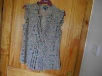 Women's sleevless top with christal buttons, size M- used once.