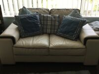 Leather sofas and stool. Immaculate condition.