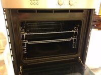 Integrated electric fan oven. Good working order, brushed steel effect. 2 shelves and grill pan