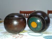 Two crown green bowls.