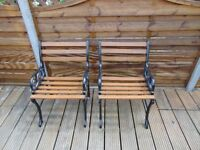 A pair of victorian cast iron ended garden seats