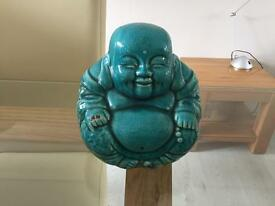 Teal buddha