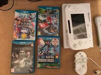 Wii U 8GB with 4 wii u Games (3 main MARIO games), 6 wii games and accessories