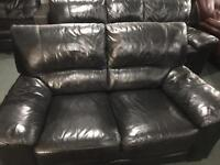 As new black leather 3 and 2 sofas