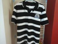 Brand new, Newcastle United Official Merchandise Newcastle Polo Shirt size Small