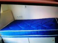 Single bed and small wardrobe