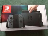 Nintendo switch with Zelda and Mario cart 8