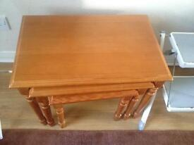 Set of three wooden tables