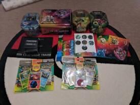 708 Pokemon cards, blister packs, tins, coins etc