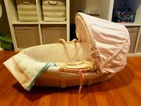 Baby girls chair. Moses basket and toys