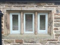 Gritstone mullion window surrounds