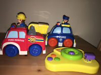 Set of 3 driving toys (fire truck, police car, drivers dashboard)