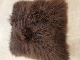 Sheepskin cushions i have 2 large grey beutiful new.
