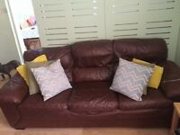 Three piece leather suite & a foot stool