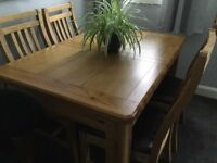 Extending oak table and 6chairs
