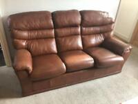 Leather sofa and reclining arm chairs and foot rest