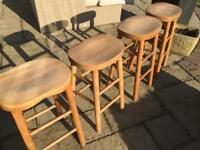 4 Solid Oak kitchen stools.
