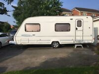 2005 ace[swift] courier 6 berth fixed rear bunk beds, blow air heating awning and annex included.