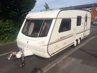Top of the range abbey spectrum 4 berth caravan with Isabella awning and motor mover