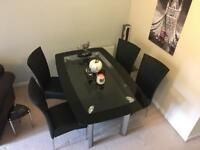 Dining Table and 4 chairs glass table leather chairs