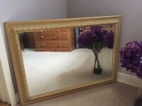 Large pale gold ornate mirror with bevel edge glass
