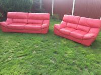 Stunning pair of modern sofaworks red full leather sofas. Free delivery